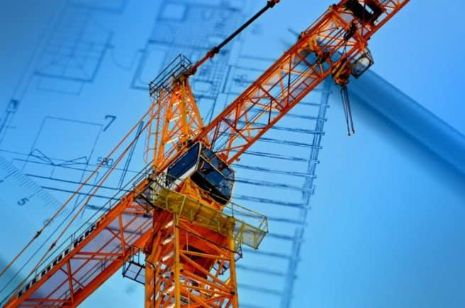 Stock Photo - Construction Crane Over Plans