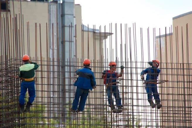 Workers on rebar stock image