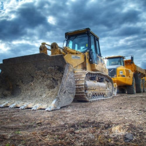 Bulldozer on dirt stock image